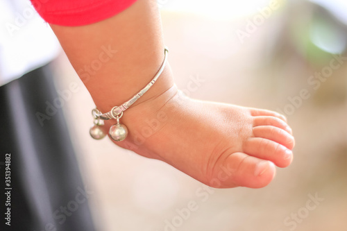 Photo Low Section Of Baby With Anklet