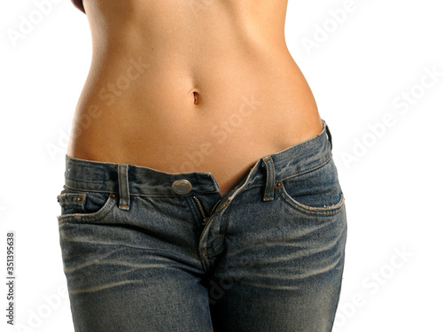 Obraz Midsection Of Slim Woman Wearing Jeans Against White Background - fototapety do salonu