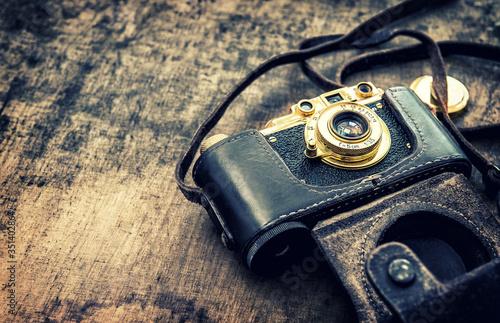 Obraz Vintage film photo camera Retro toned picture - fototapety do salonu