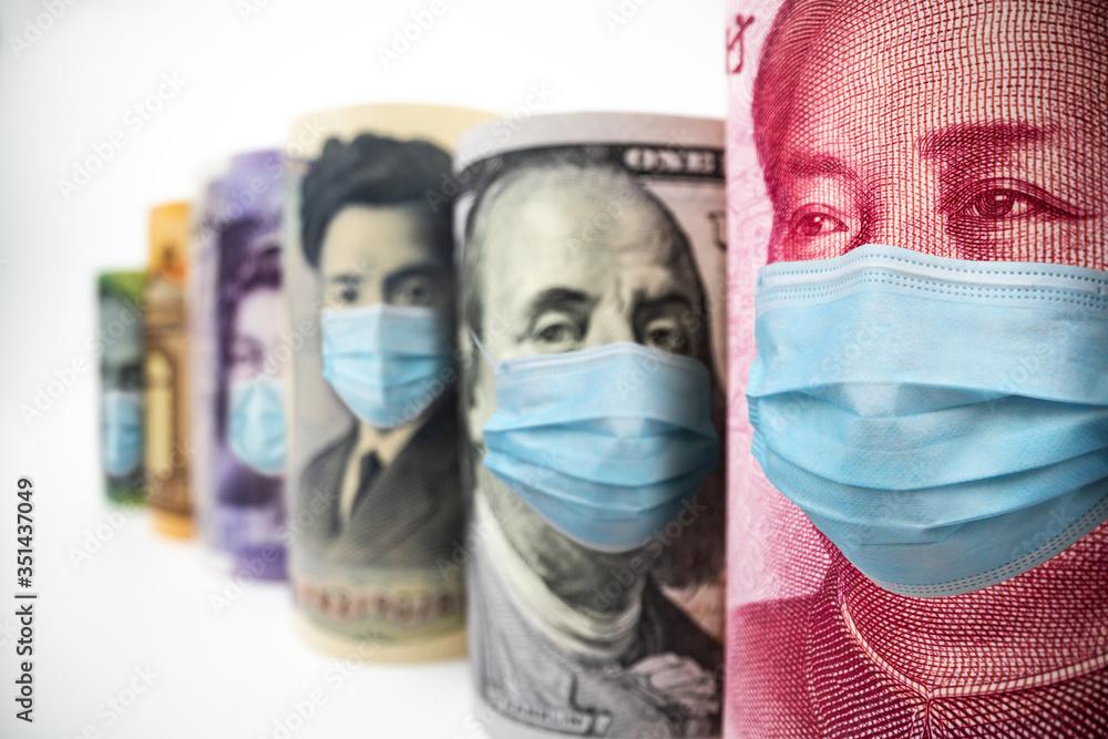 Fototapeta International currency money include US American Dollar, Euro Currency, British UK Pound, Australian Dollar, China Yuan and Japan Yen face mask concept of coronavirus disease COVID-19 economic crisis.