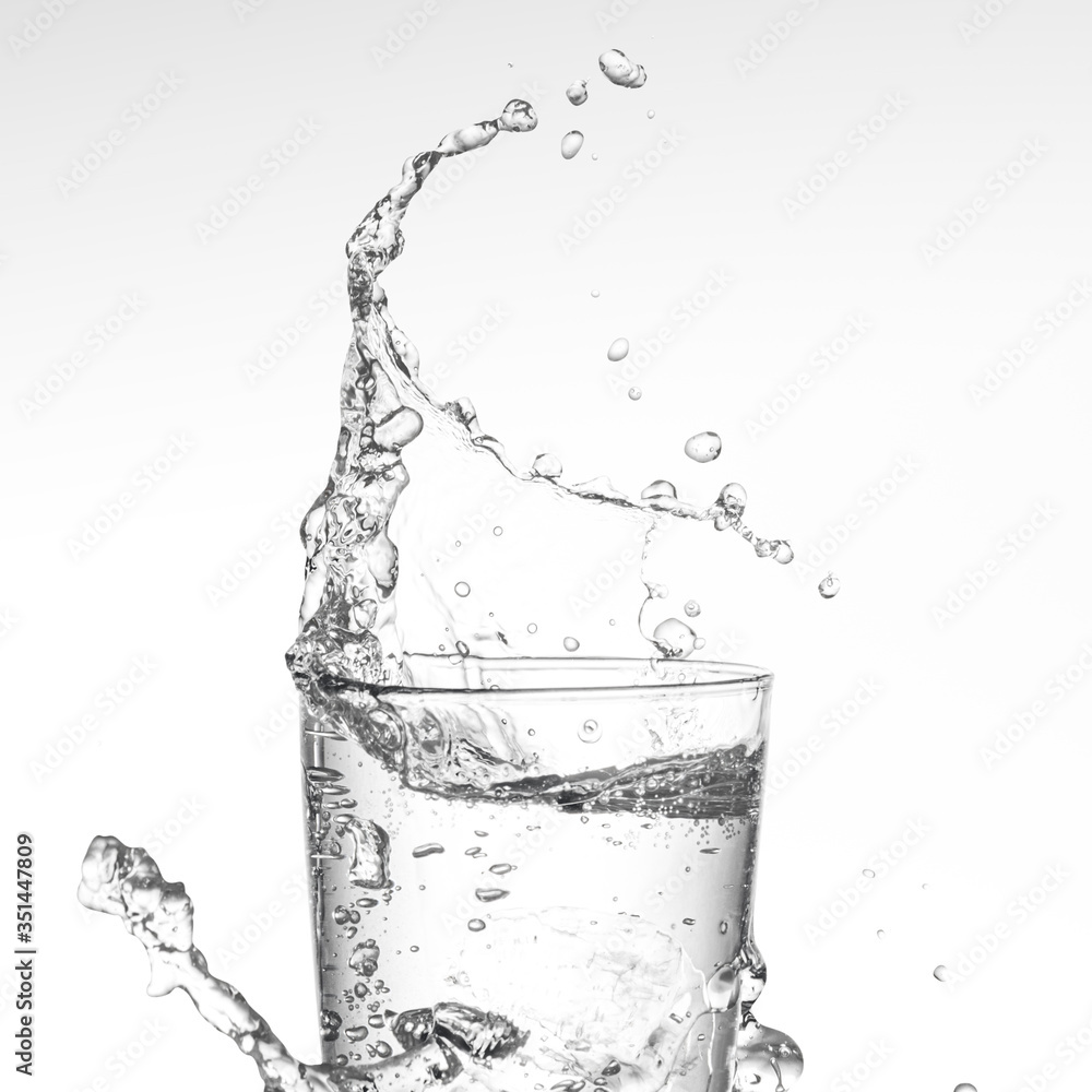 Fototapeta Water splashing from glass