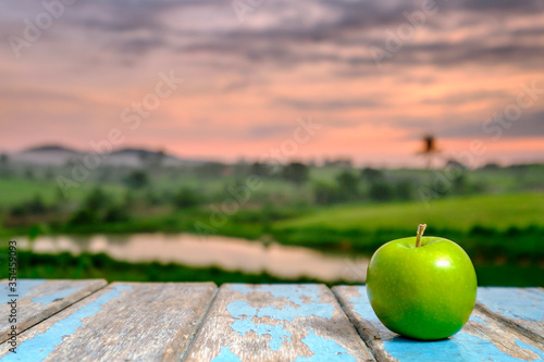 Granny Smith Apple On Table Against Sky During Sunset Poster Mural XXL