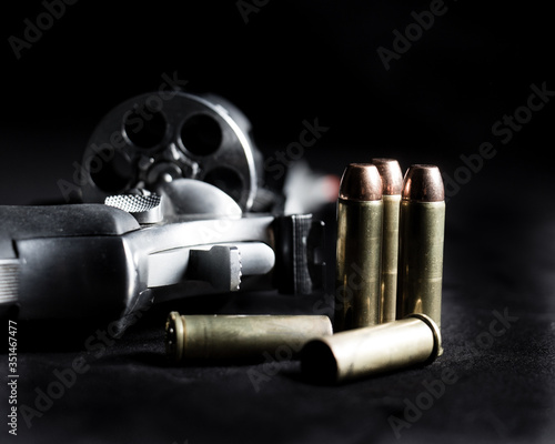 Photo Close-up Of Gun And Bullets Against Black Background