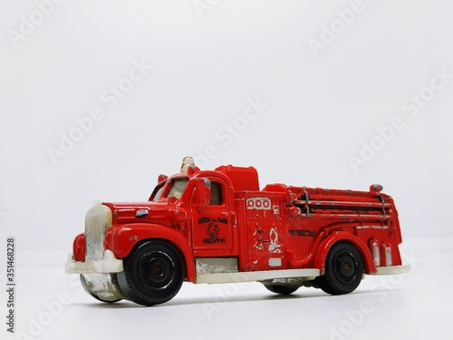 Red Toy Fire Engine Against White Background Fototapet