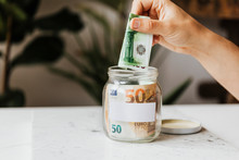 Saving Money In A Jar During T...