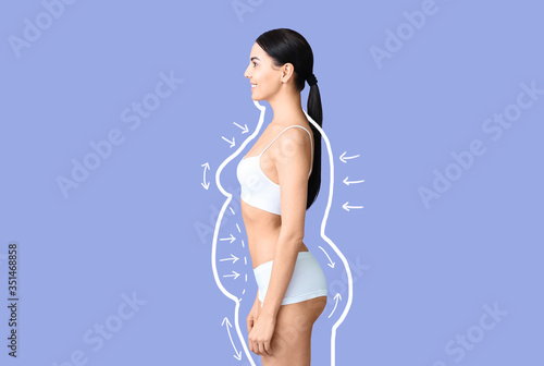 Young woman after weight loss on color background Fototapet