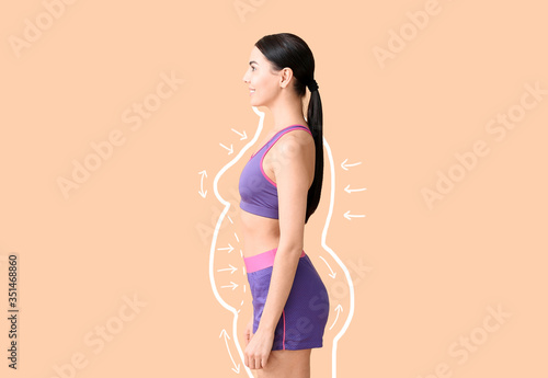 Photo Young woman after weight loss on color background