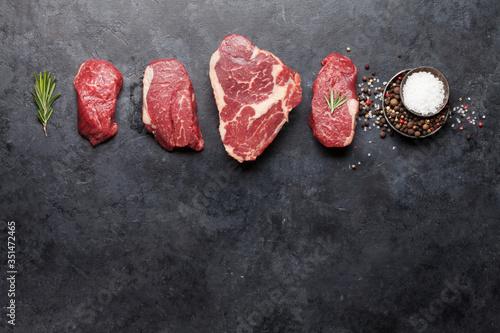 Obraz Variety of fresh raw beef steaks - fototapety do salonu