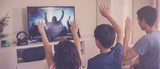 Children praying with father parent , family and kids worship online together at home, streaming church service, social distancing, isolation, lockdown concept