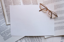 Glasses For Visual Acuity Over Printed Documents And A Dictionary. Paperwork. Regulatory Or Translation Service.
