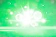 Leinwandbild Motiv White bokeh light on a green background