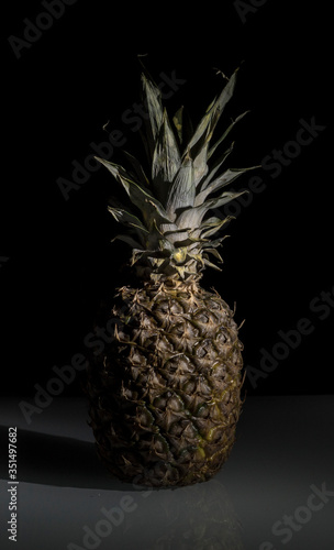 Fototapety, obrazy: Close-up Of Pineapple On Table Against Black Background
