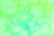 Leinwandbild Motiv Bokeh pattern on a bright green background