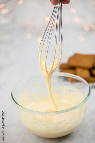Fototapeta Close-up Of Wire Whisk Stirring Cream obraz