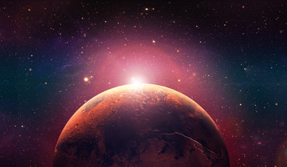 Mars the red planet. Sunset on mars.  Red planet in the space full of stars.