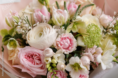 Spring pastel bouquet with roses closeup. Peony rose. Tulips,ranunculus. Flower shop. Spring. Florist. Flower Background. Wallpaper.Woman's day. © E