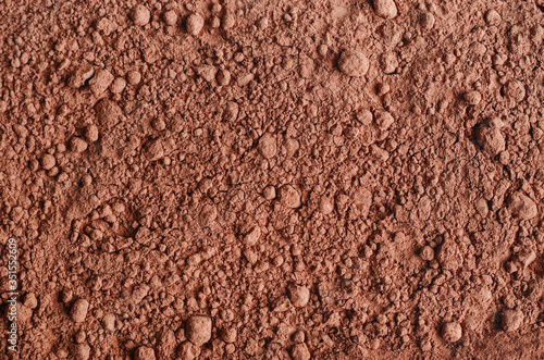 Photo Dry cocoa powder background close up.