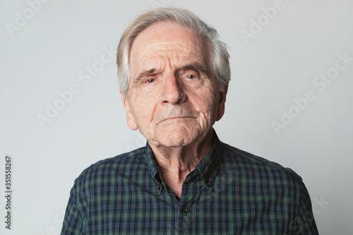 Displeased senior man in a studio shoot