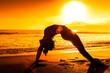 Woman Exercising At Beach During Sunset
