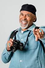Happy Senior Man With A Digital Camera