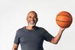 Senior coach holding a basketball