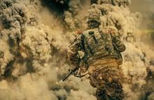 Soldier Running Between Smoke ...