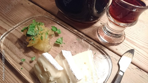 Fotografia Close-up Of Cheese With Walnut Schnapps Served On Table
