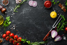 Black Stone Cooking Background. Spices And Vegetables. Top View. Free Space For Your Text.