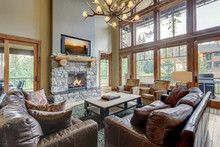 Amazing Two Story Tall Living Room Interior  With Sky Bridge And Leather Furniture.