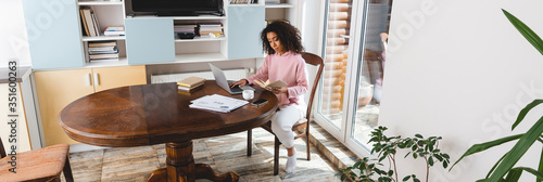 Obraz horizontal image of african american freelancer working from home - fototapety do salonu