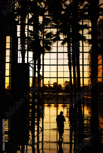 The sunset is seen through the glass atrium of the World Financial Center in New Canvas-taulu