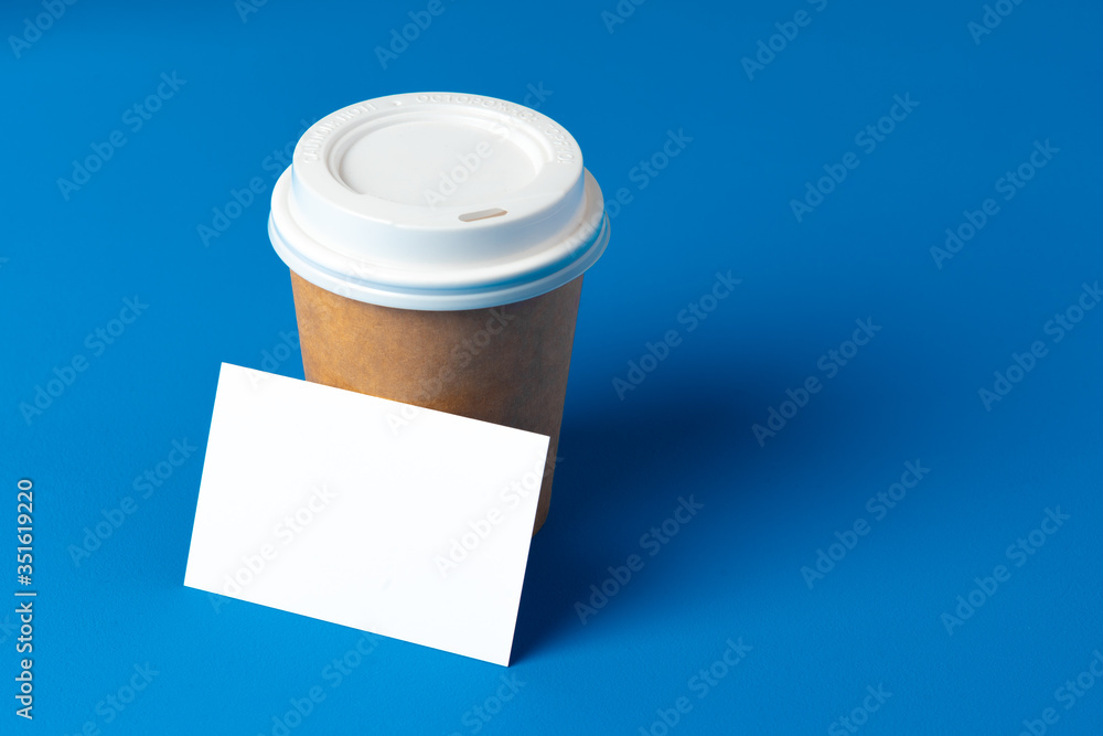 Fototapeta Blank takeaway coffee cup and white businesscards