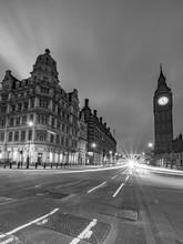 Light Trails On Street Against Big Ben At Night
