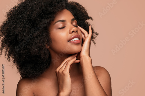 African American woman touching clean skin Canvas Print