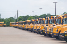 Idle School Buses Await The Re...