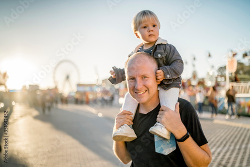 Happy father with his little son in an amusement park Canvas Print