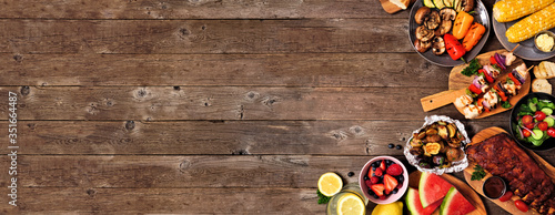 Summer BBQ or picnic food corner border over a rustic wood banner background Canvas
