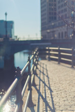 Railing By River In City
