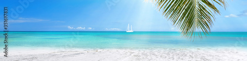 Fototapeta Sunny tropical Caribbean beach with turquoise water background, sail boat in lagoon obraz