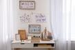 Leinwandbild Motiv Stylish room interior with creative workplace near white wall