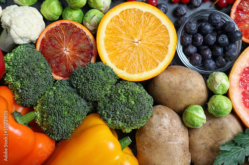Obraz Different products rich in vitamin C on table, top view - fototapety do salonu