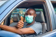 African Driver Wearing A Face Mask, Doing The Thumbs Up Gesture