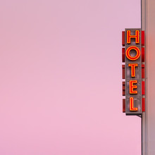 Neon Hotel Sign On The Buildin...