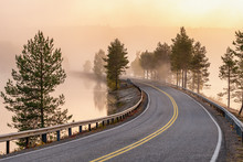 Finnish Landscape With Narrow Car Road Through The Lake.