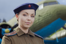 A Young Female Pilot In Unifor...