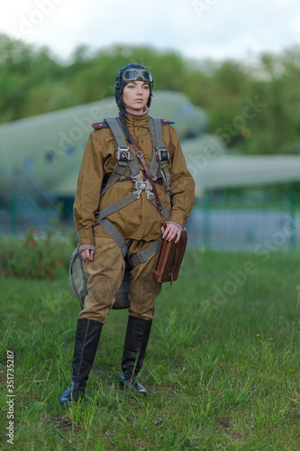 Obraz na plátne A young female pilot in uniform of Soviet Army pilots during the World War II