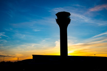 London Luton Aiport's Control Tower In The Sunset. Silhouette Picture.