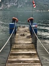 Ducks Relaxing On Pier Amidst Lake