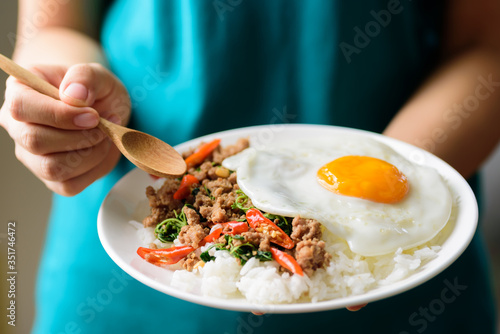 Thai food, stir-fried holy basil with minced pork and fried egg (Pad Kaprao Moo Wallpaper Mural