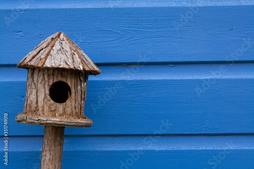 Canvas Close-up Of Birdhouse Against Blue Wooden Wall